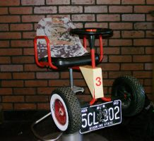 antique kids barber chair by Irie-Stock