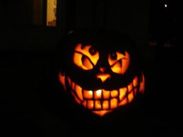 Evil Cheshire Cat Pumpkin by keeper-of-vilya