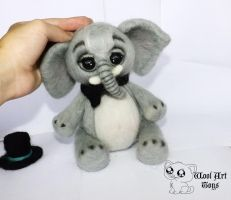 Needle felted cute gray baby elephant with a hat by WoolArtToys