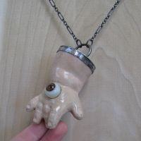 Gigantic Eye Hand Necklace by bugatha1