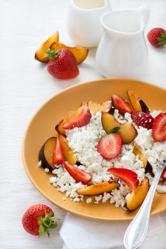 Cottage cheese with strawberries and plums by BeKaphoto
