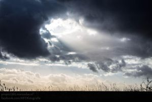 Hole in the clouds by Marcodaz