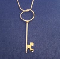 Gold and Silver Key Pendant by GipsonDiamondJeweler