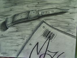 knife and notebook by joogerson