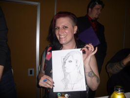 Kat at Crypticon holding Quick Drawing II by Poorartman
