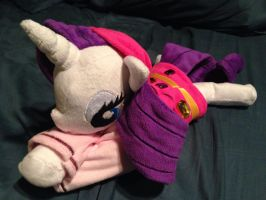 Rarity beanie bundled in her Gala hoodie by Cheferoni