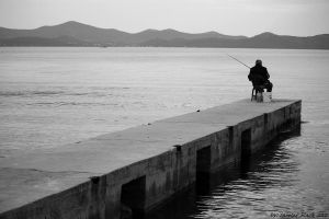 I am an old fisherman by labeled-black
