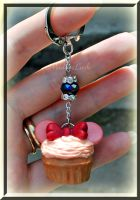 Minnie Mouse cupcake keyring by MadamLuck
