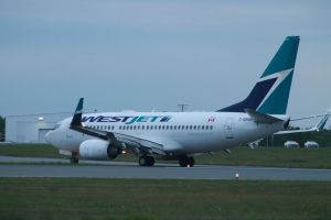 Westjet 737-700 turning onto the taxiway by tdogg115