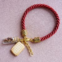wine-colored bracelet and cookies by amalie2
