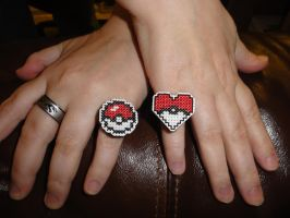 Pokeball and Pokeball Heart rings by Sew-Madd