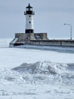 Lake Superior light house in the winter by Nipntuck3