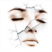 cracked face by theicon92