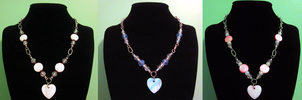 Heart Shell Necklaces by BloodRed-Orchid