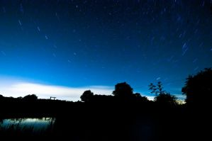 Star Trails over A Lake by Foxseye