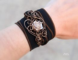Vintage rose wire wrapped wrist band by IanirasArtifacts