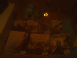 My Assassin's Creed stuff and 2 Dragon plushies by Dragonrage19