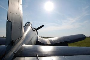 Vought F4U Corsair in the Setting Sun by comradeloganov