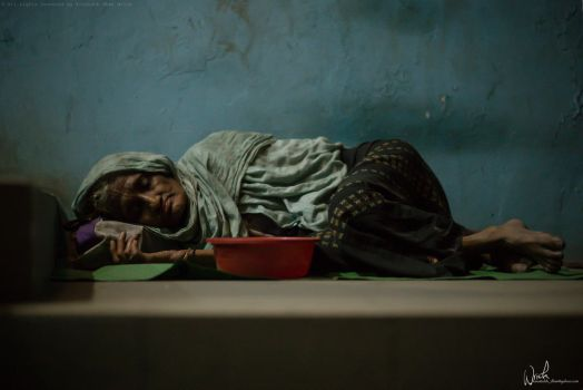 Homeless Mother take shelter in Stairs by Koustubh-Dhar-Wrick