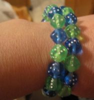 Blue and green memory wire dice bracelet by BlackUnicornWood