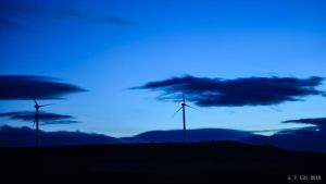Wind Turbines At Dusk by AFL