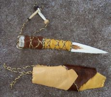 Bone knife with hide sheath 1 by lupagreenwolf