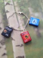 The Hunger Games trilogy book bracelet/keychain by InsaneJellyBean95