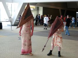 Two Pyramid Heads by AngstyGuy