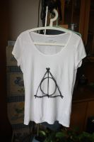 the Deathly Hallows symbol T by EvelynY