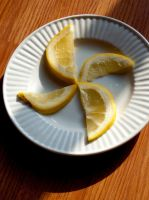 Grapefruit Slices on a Plate by JosephIrwin