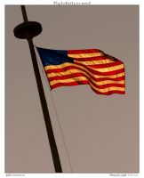 Flag backlit by sun second by yellowcaseartist