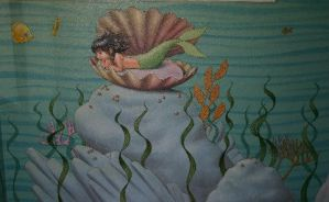 Wall with little miss mermaid by MuralsbyLeBold