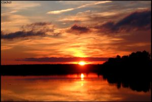 Sunset over a lake 3 by Tjahzi