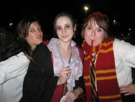 Hermione, a Weasley, and Harry by Rodenkovia