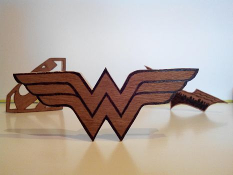Wonder Woman emblem in scroll saw and pyrography by tokita59