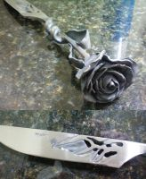 Metal Rose Knife Close Up by Logan-Pearce