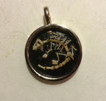 Lizard skeleton pendant by Boxyqueens