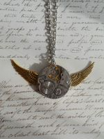 Steampunk mechanism necklace with gold wings by SteamJo