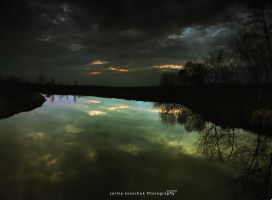 Cloudy sunset Lake Reflection by frayart