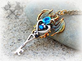 Gold and Sapphire Crystal Dragon Key Necklace by ArtByStarlaMoore
