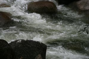 Rushing River Water Close-Up by Mind-Matter