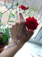 Hand and rose by Quiriter