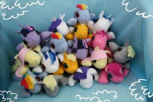 Pile of Pony Plushies by bluepaws21