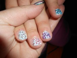 pink rhinestones on blue nails by Agathanaomi