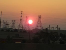 Sunset through the powerlines by Selth-Afrinon