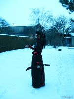 Kanda stands in the snow by Yuzukiii