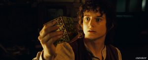 Frodo with the lemarchand's box from Hellraiser by OmniRoy