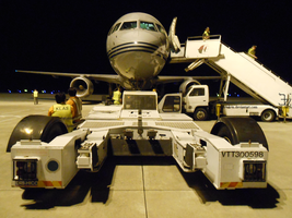 Airport 20150412 _ tow truck and plane by K4nK4n