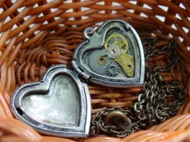 Steampunk heart locket by Hiddendemon-666