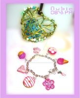 Heart and charm bracelet comis by colourful-blossom